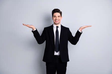 Portrait of handsome stylish sales agent discount present demonstrate advert options choice decision feel satisfied excited entrepreneur success wear modern clothing isolated ashy-gray background