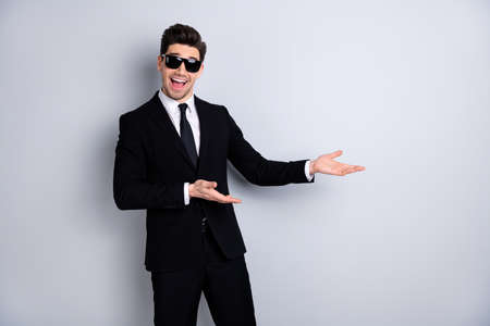 Stylish product concept. Portrait handsome smart real estate agent advise decide give information ad suggest excited content candid enjoy isolated grey background specs eyewear eyeglasses outfit