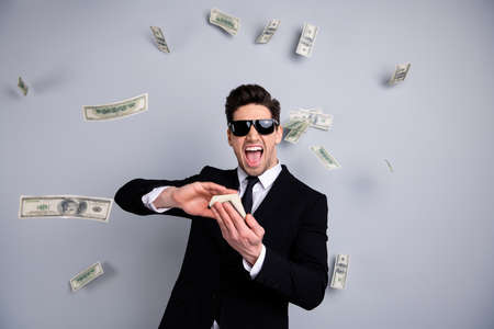 Portrait of his he nice attractive cheerful guy professional executive leader expert development agent broker financier banker throwing away exchange lottery credit isolated over light gray background Stok Fotoğraf