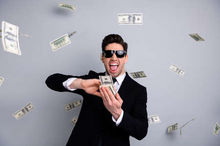 Portrait of his he nice attractive confident cheerful cheery crazy arrogant guy manager financier banker economist throwing away currency exchange lottery credit isolated over light gray background