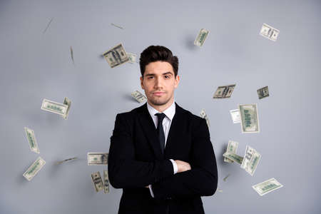 Portrait of his he nice attractive content guy top manager financier banker economist sum currency lottery credit loan flying in air blow wind agent broker isolated over light gray background