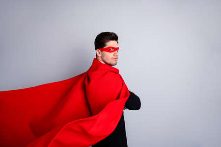 Close up side profile photo adventurous rigorous facial expression he him his man threaten use superpower wear red long cloak raised wind safety protection human race concept isolated grey background