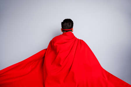 Close up back rear behind view photo hiding facial expression he him his man ready flight use superpower wear red long cloak raised wind safety protection human race concept isolated grey background Stok Fotoğraf