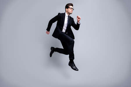 Full length body size view portrait of his he nice elegant imposing attractive worried guy diplomat white collar running fast career growth isolated on light gray background