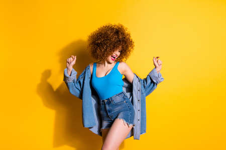 Portrait of  nice cute lovely girlish charming attractive winsome glamorous cheerful cheery optimistic positive girl having fun time isolated over bright vivid shine yellow background Stock Photo - 127741377