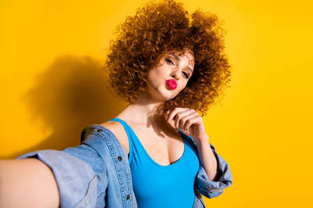 Self-portrait of nice cute lovely charming attractive winsome sweet cheerful cheery wavy-haired girl sending you kiss isolated over bright vivid shine yellow background Stock Photo