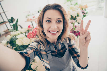 Close up photo beautiful she her lady blogger make take selfies show v-sing followers different various option retail seller offering buy buyer big choice choose owner small flower shop room indoors Stock fotó