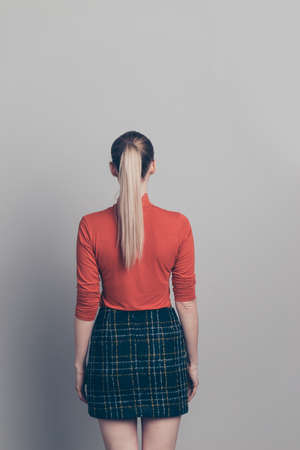 Vertical rear back behind view portrait of her she nice-looking pretty attractive fashionable girl wearing red sweater checked shirt isolated over gray pastel background