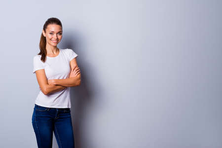 Close up photo beautiful amazing she her lady hands arms crossed self-confident easy-going reliable business person wondered look wear jeans denim casual white t-shirt isolated grey background
