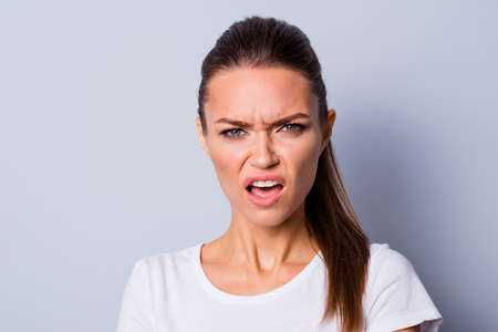 Close up photo amazing beautiful she her lady not fear situation epic fail bad mood grimacing deny fault guilty sorry stress wear casual white t-shirt clothes isolated grey background