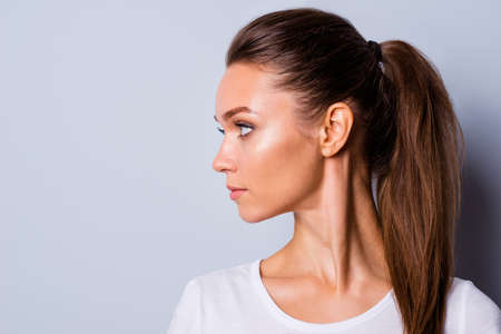 Close up side profile view photo amazing beautiful she her lady perfect appearance look side empty space not smiling reliable person wear casual white t-shirt clothes isolated grey background