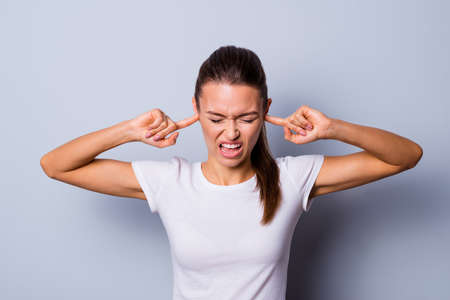 Close up photo amazing beautiful she her lady not fear situation epic fail bad mood eyes closed hide ears fingers terrible noise headache wear casual white t-shirt clothes isolated grey background
