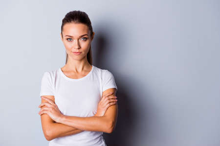 Close up photo beautiful amazing she her no smiling lady perfect appearance crossed self-confident easy-going listening good news sure such results wear casual white t-shirt isolated grey background