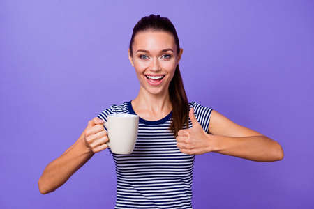 Portrait funny funky cute lady millennial demonstrate cheerful beautiful ads adverts choice decision excellent beverage hot reaction content candid isolated striped t-shirt purple violet background Stock fotó - 123312144