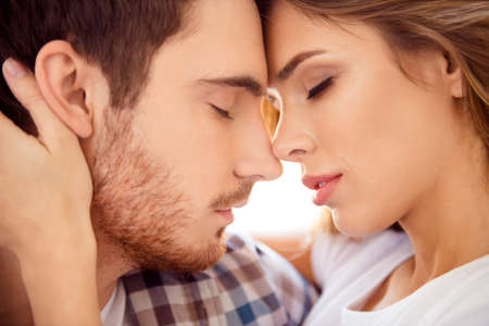Close-up cropped portrait of his he her she nice-looking gorgeous attractive charming bearded guy caressing lady ideal match honey moon in light white style interior hotel house indoors Banque d'images - 123312466