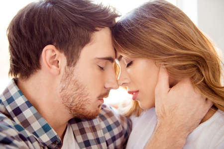 Close-up profile side view portrait of his he her she nice-looking attractive charming sweet bearded guy caressing lady ideal match soulmate in light white style interior hotel house indoors Banque d'images - 123312468