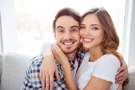 Close-up portrait of his he her she nice-looking adorable attractive charming tender guy caressing lady ideal match soulmate date in light white style interior hotel house indoors