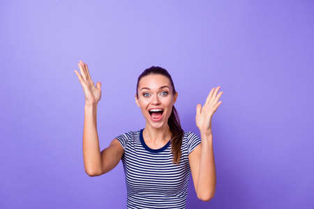 Portrait pretty funny funky millennial raise hands heard news novelty impressed astonished shout incredible wonder victory thrilled clothing striped t-shirt isolated purple violet background Foto de archivo - 123313802