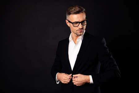 Portrait of his he nice attractive classy chic content leader sales real estate top professional career ceo boss chief financier economist banker clerk fixing button isolated over black background