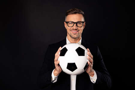 Close-up portrait of his he nice-looking attractive content cheerful cheery professional director holding in hands ball career development growth progress isolated over black background Zdjęcie Seryjne