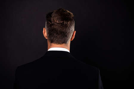 Close-up rear back behind view portrait of his he nice attractive well-groomed chic guy wearing jacket blazer isolated over dark black background