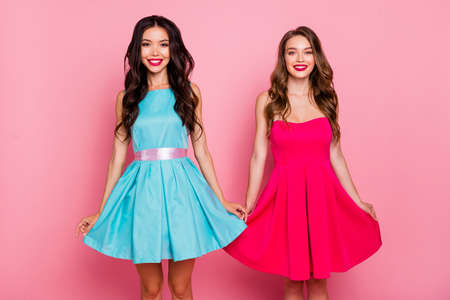 Close up photo two beautiful she her ladies graduation classy coquettish adorable showing prom partners pretty nice cute shiny colorful dresses formal-wear isolated pink rose vivid background