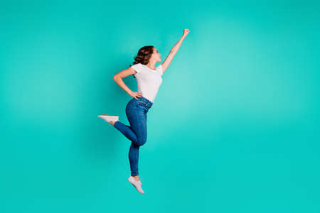 Full length body size profile side view of her she nice-looking attractive cheerful slim fit thin slender wavy-haired lady raising hand up aim isolated on bright vivid shine blue background