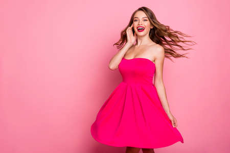 Close up photo beautiful she her dancing prom queen lady wind flight blow air skirt laughter plump allure rose lips graduation party wear cute shiny colorful dress isolated pink bright background 版權商用圖片