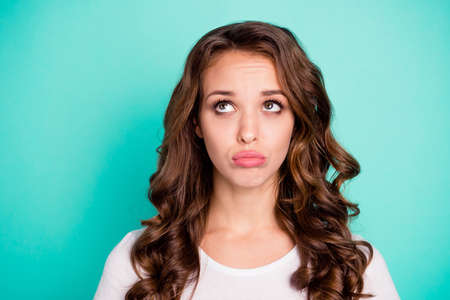 Close-up portrait of her she nice-looking attractive lovely charming gorgeous offended sad displeased wavy-haired lady blowing lips isolated on bright vivid shine blue background