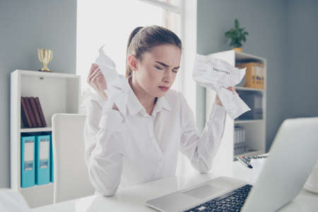 Close up photo beautiful she her business lady suffer eyes closed hold arms hands wrong documentation listen inline skype chief scolding notebook table bright office wear specs formal-wear white shirt