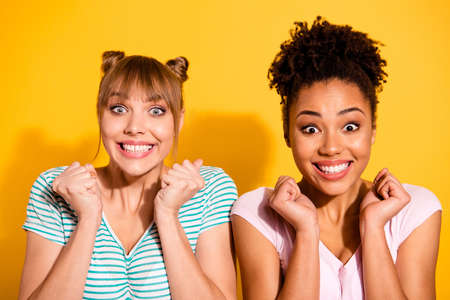 Close up photo beautiful roar she her lady hands arms fists raised amazed different nationalities sale discount shopping wear casual white striped t-shirt clothes isolated yellow bright background Banque d'images