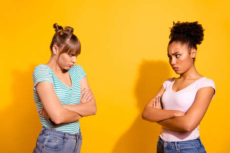 Profile side view photo of sad disappointed teen teenager have disagreement frown have wavy curly hair hairdo top-knot shadow jeans stylish style t-shirt hipster sullen isolated on yellow background