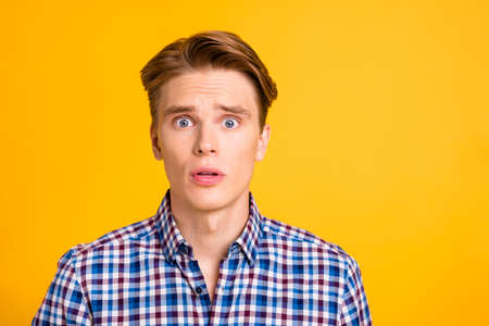 Close up photo amazing he him his man ideal perfect hairstyle styling mouth open eyes full fear oh no facial expression wear casual plaid checkered shirt outfit isolated yellow bright background.