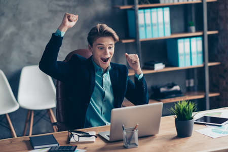 Portrait of delighted astonished cute collar raise fists scream shout yeah wear tux tuxedo blazers suit luck lucky aims get income funds profit development start-up celebrate content industrial loft.