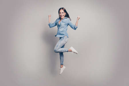 Full length body size view portrait of nice-looking attractive lovely charming pretty adorable cheerful optimistic straight-haired lady having fun rejoicing isolated over gray background.