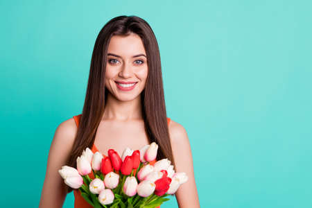Close up photo beautiful amazing her she lady hands arms fresh flowers white red tulips surprise holiday anniversary birthday wear casual orange tank-top isolated bright teal turquoise background
