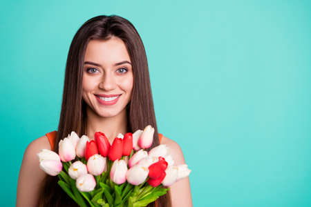 Close up photo beautiful amazing her she lady hands arms fresh flowers white red tulips surprise holiday anniversary party wife wear casual orange tank-top isolated bright teal turquoise background