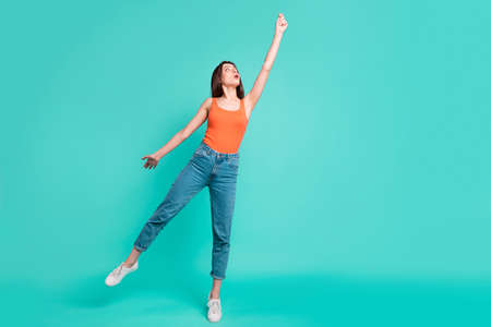 Full length body size photo beautiful her she lady easy-going weekend vacation freedom flight imaginary umbrella wear casual orange tank-top jeans denim isolated bright teal turquoise background Stock Photo