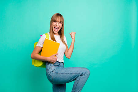 Close up side profile photo beautiful she her lady yelling bast test results arms hands school colored notebooks staff modern backpack wear specs casual white t-shirt isolated teal green background Stockfoto