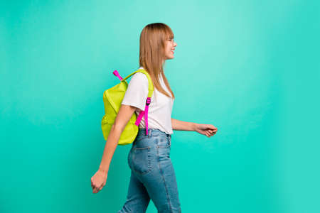 Close up side profile photo beautiful funny she her lady modern backpack going meet classmates groupmates before classes lessons wear specs casual white t-shirt isolated teal green background