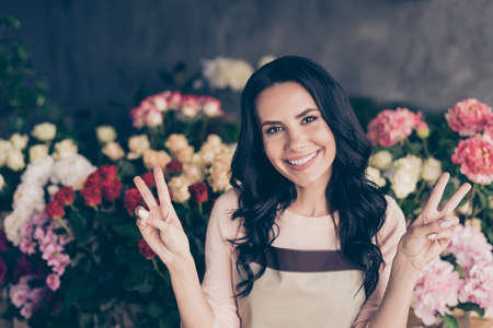Close-up portrait of her she nice-looking attractive lovely charming cute winsome sweet cheerful cheery mature wavy-haired lady girlfriend showing double v-sign workplace