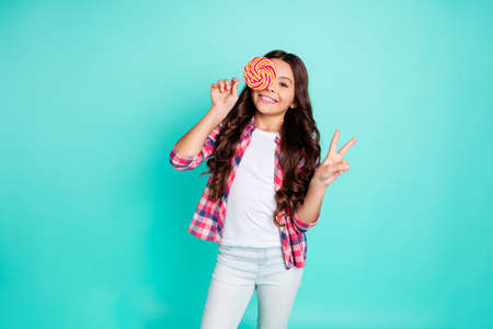 Portrait cute playful positive cheerful satisfied content lady little free time weekend holidays make v-signs hold hand long haircut trendy stylish beautiful checked shirt isolated teal background 写真素材