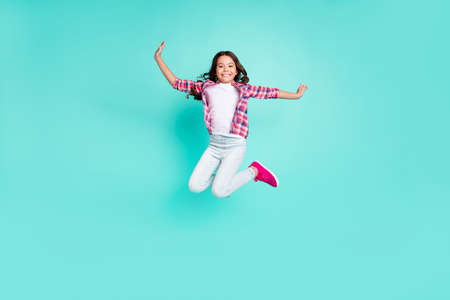 Full length body size view photo lovely nice kid have funny funky enjoy content rejoice trip travel vacation trendy stylish move raise hands checkered clothing isolated turquoise background 版權商用圖片