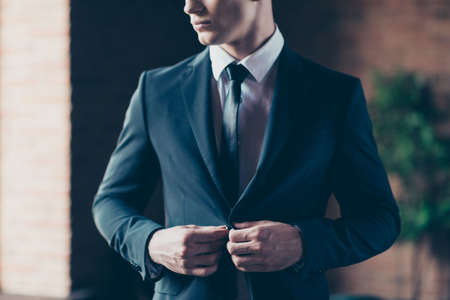 Cropped close up photo perfect fashion look handsome he him his thoughtful keep silence calm self-confident button up jacket wear formal-wear shirt tie suit costume indoors modern office place