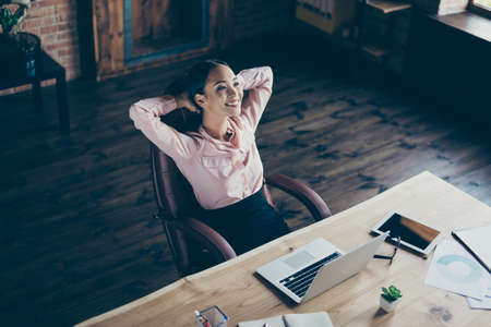 Above high angle view portrait of her she nice attractive stylish trendy cheerful lady economist financier real estate sales having rest time at industrial loft style interior work place station