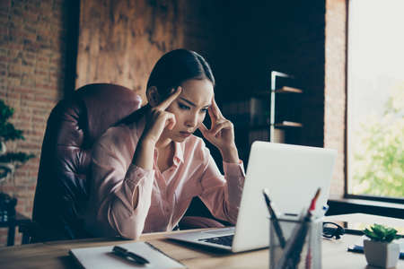 Portrait of her she nice-looking attractive focused lady top management specialist ceo boss chief difficult task at modern industrial loft interior style work place station