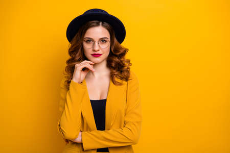 Portrait of her she nice-looking charming cute attractive lovely content chic luxury well-groomed wavy-haired lady in yellow jacket isolated on bright vivid shine orange background Stock Photo - 124258485