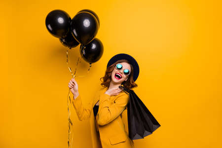 Close up side profile photo beautiful she her lady laugh laughter carry packs perfect look buy buyer present gift birthday discount wear specs formal-wear costume isolated yellow bright background Stock Photo