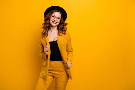 Portrait of her she nice-looking charming cute attractive lovely chic elegant cheerful cheery wavy-haired lady in yellow jacket blazer luxury lifestyle isolated on bright vivid shine orange background Stock Photo