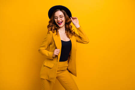 Portrait of her she nice charming cute attractive lovely fascinating adorable fashionable chic cheerful cheery wavy-haired lady wearing yellow jacket isolated on bright vivid shine orange background